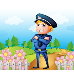 A policeman standing in the garden vector image