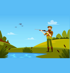 man stands holding shotgun to duck hunting vector image