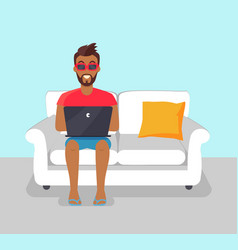 cheerful bearded man freelancer working at home vector image