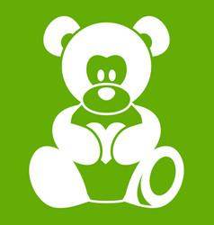 teddy bear holding a heart icon green vector image
