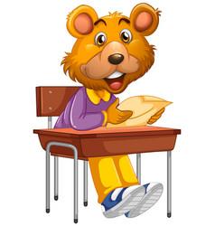 Bear sitting in school desk vector