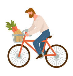 man riding bike with carrots in basket vector image