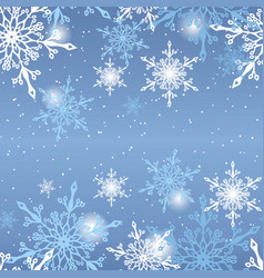 Snowflakes on blue background pattern vector