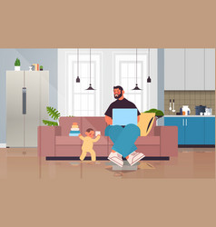 Father playing with little son and using laptop vector