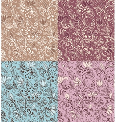 Four floral patterns vector image