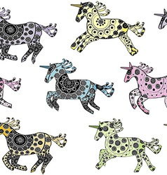 Seamless with cartoon unicorns over a white vector image vector image