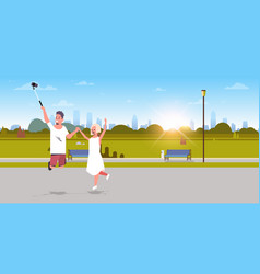 young couple using selfie stick taking photo on vector image