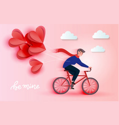 young riding bicycle and holding red heart paper vector image