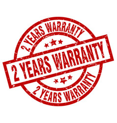 2 years warranty round red grunge stamp vector image