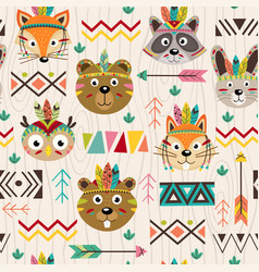 Seamless pattern with tribal animals faces vector