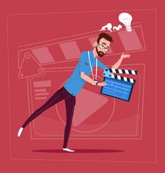 Man holding clapperboard modern video blogger vlog vector