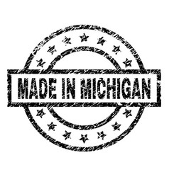 Scratched textured made in michigan stamp seal vector