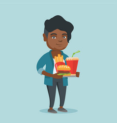 African woman holding tray full of fast food vector