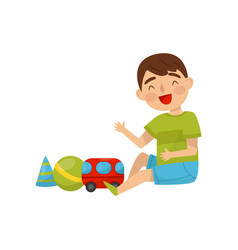 cute boy sitting on the floor playing with toys vector image