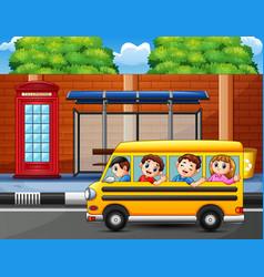 Happy kids to ride the school bus vector