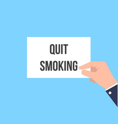 Man showing paper quit smoking text vector