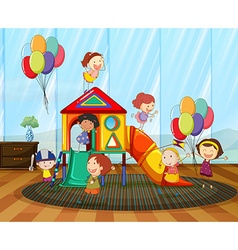 Children playing on the slide in the room vector