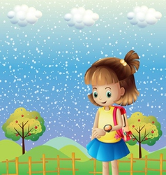 A child with a backpack and a watch near the hills vector