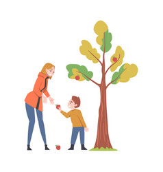 Young woman with kid picking apples from fruit vector