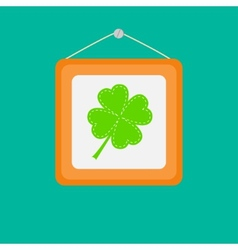 Four leaf clover in a picture frame on the wall vector image