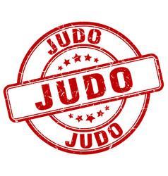 Judo red grunge round vintage rubber stamp vector