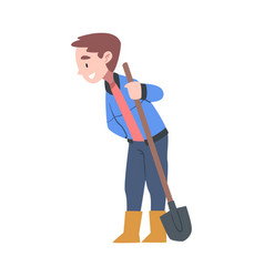 Little boy in rubber boots standing with shovel vector