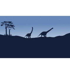 Silhouette of argentinosaurus on the hill vector image vector image