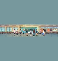mix race group of school children in classroom vector image