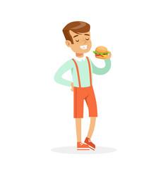 smiling boy eating hamburger colorful character vector image vector image