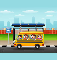 Happy children riding by school bus vector
