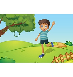 A happy boy waving while running in the hill vector