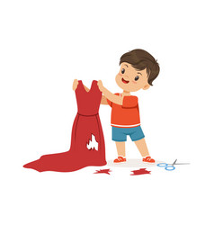 Cute little bully boy cutting red mothers dress vector