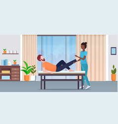guy lying on massage bed african american masseuse vector image