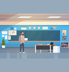 School classroom interior with male teacher vector