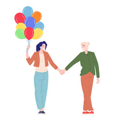 woman and man walking with balloons vector image
