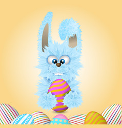 blue easter bunny is holding painted and decorated vector image