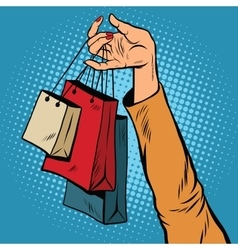 Sale bags packages in the hands of women vector