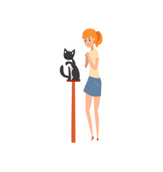 Young woman presenting her black purebred cat to vector