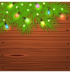 Christmas tree branches and light bulb on wooden vector image
