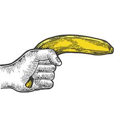 Hand aiming banana as pistol engraving vector