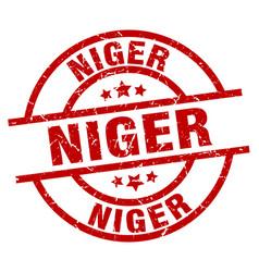 niger red round grunge stamp vector image