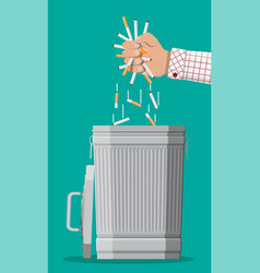 hand putting cigarettes in trash bin vector image