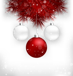 Multicolored christmas balls on red pine branches vector