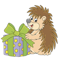 Little hedgehog with a holiday gift vector