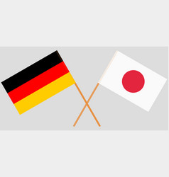 The crossed japan and germany flags vector