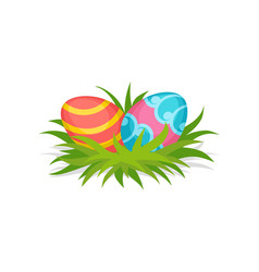 two painted eggs on green grass happy easter vector image