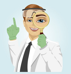young doctor with magnifying glass vector image