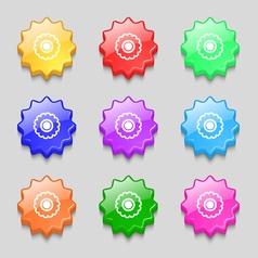 cogwheel icon sign symbol on nine wavy colourful vector image