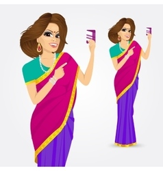 Indian woman holding a credit card vector