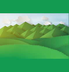 paper art of green grass and mountains on a vector image